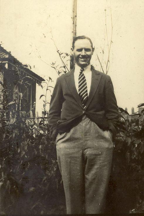 Gentleman standing in a garden