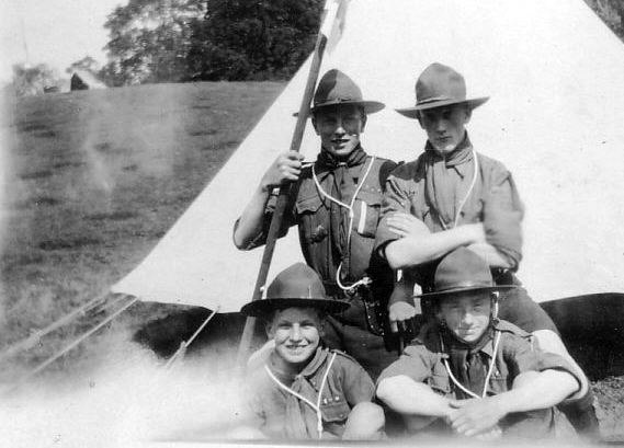 Four scouts at camp
