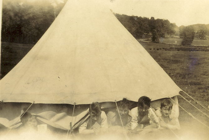 Scouts emerging from bell tent