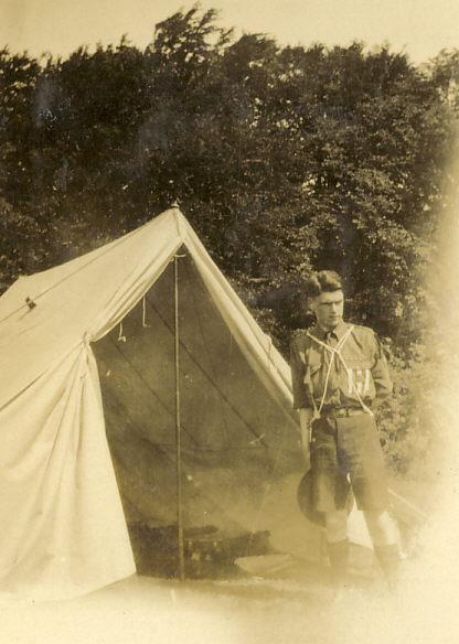 Scoout Troop Leader standing in front of ridge tent