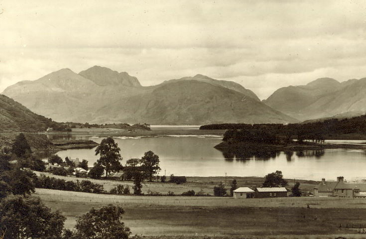 Highland View - houses, loch and mountains