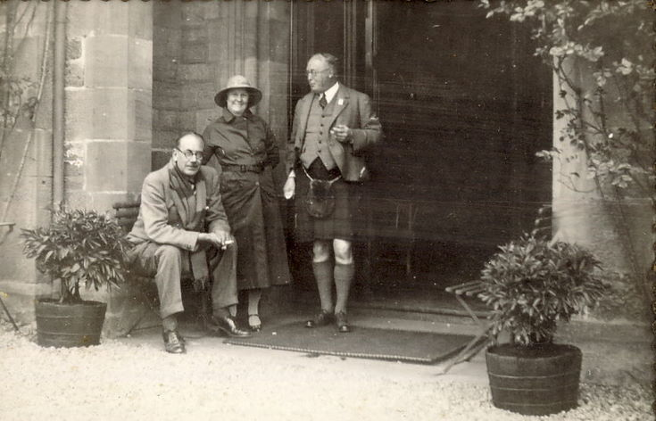 Two Gentlemen and a Lady, thought to be at the entrance to Skibo Castle
