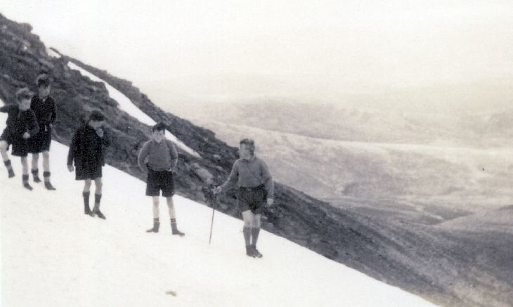 Scouts climbing in snow