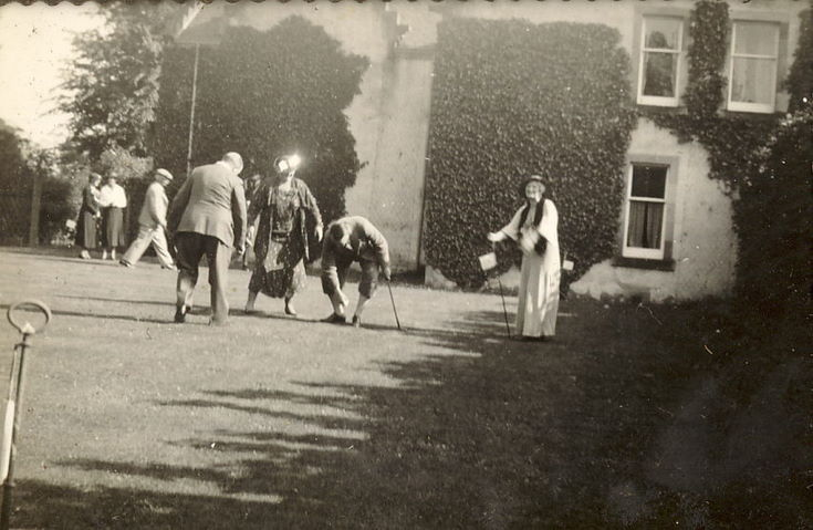 Group playing Croquet