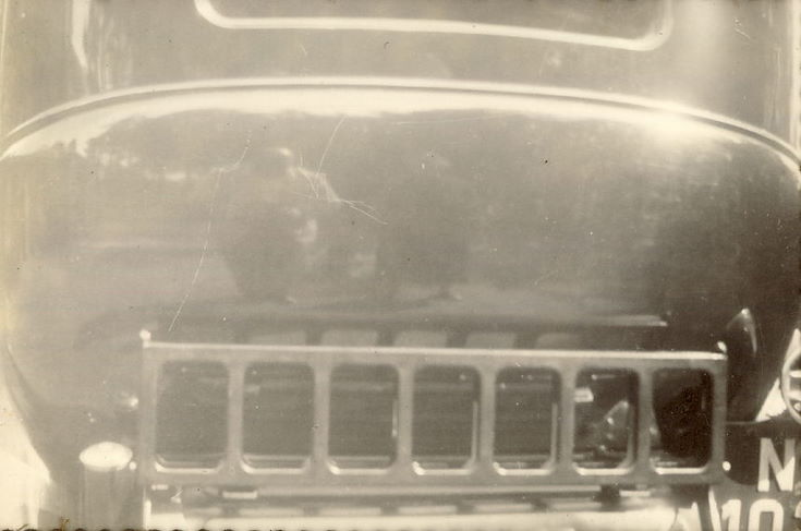 Reflection of Man and Woman (prob. Mr. and Mrs. Hardie) in car