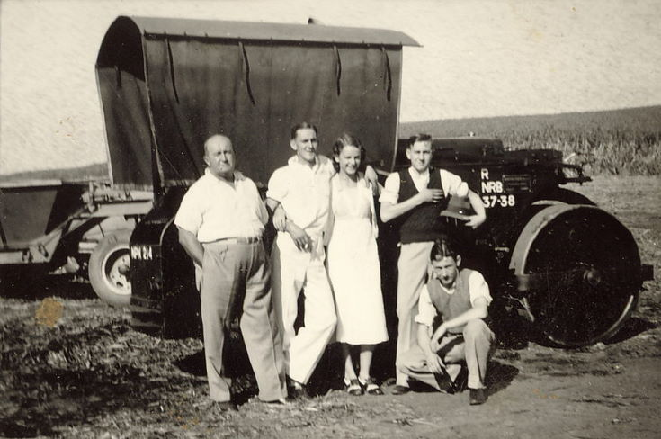 Thomas Hardie, together with three young men and a young woman, in front of a steam roller/tractor