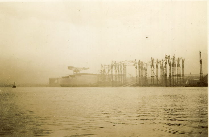 Ship under construction, surrounded by Cranes