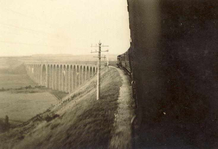 Train approaching a viaduct