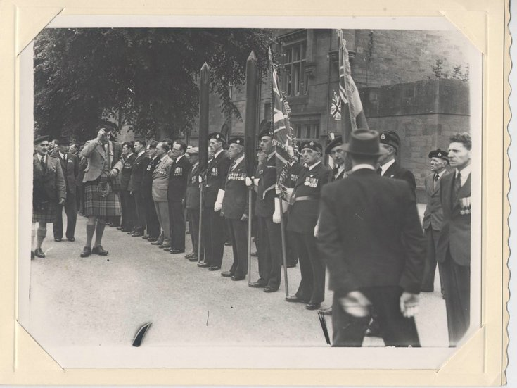 Inspecting officer salutes new King's Colours 1951