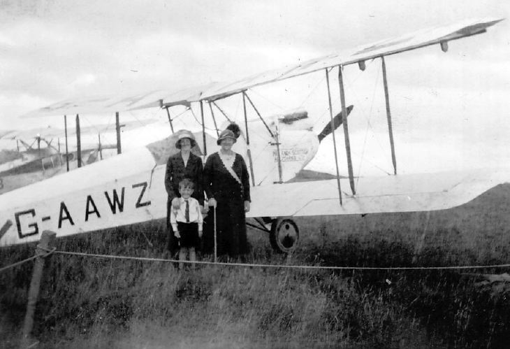 Two Women and a Boy standing in front of G-AAWZ