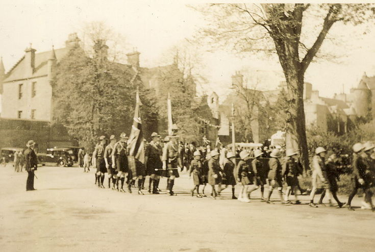 Girl Guides and Boy Scouts parading in Dornoch Square