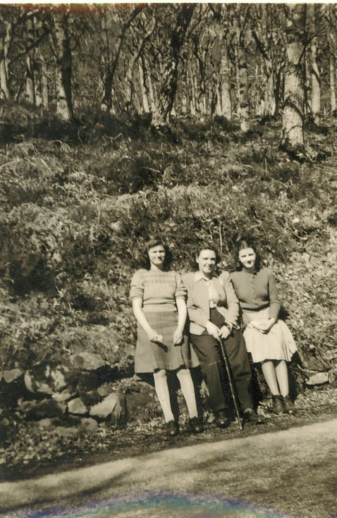 Group of lady and  two girls sitting beside road