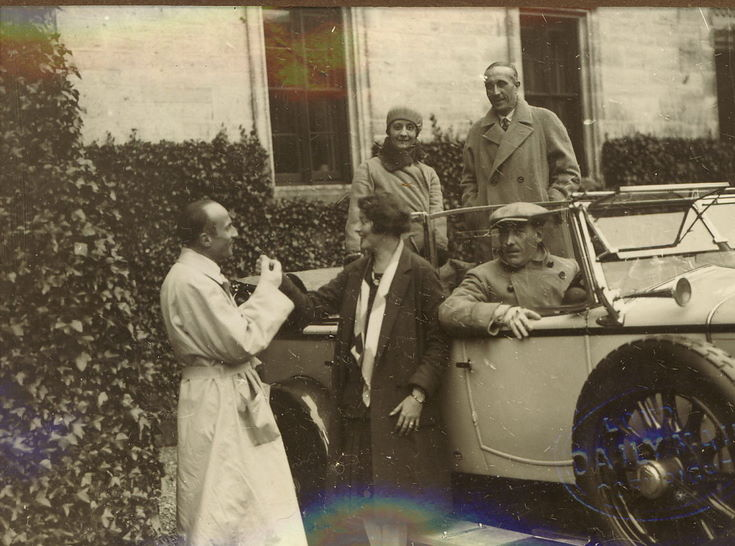 Group of five people and car at time of 1928 pageant