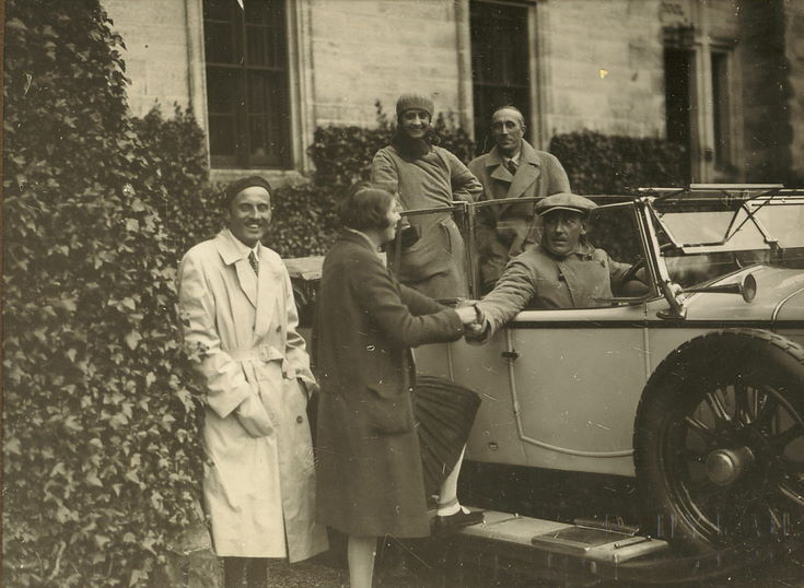 Group of five people and car taken at time of 1928 pageant