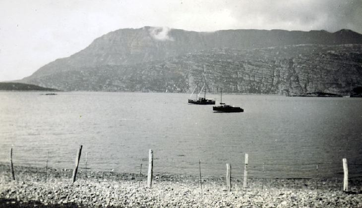 Two boats at anchor in a loch