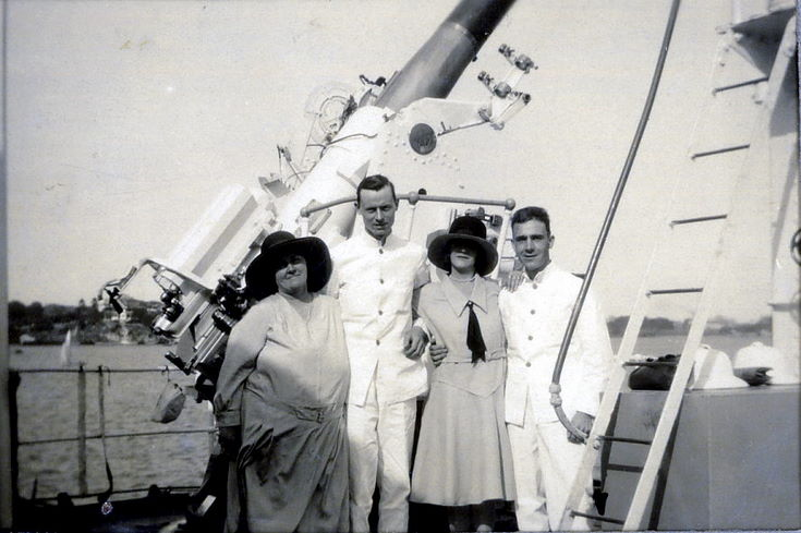 Two couples in front of a naval gun