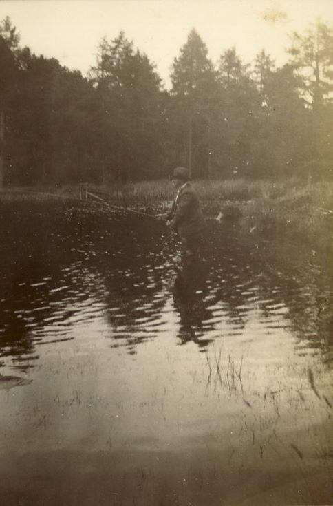 Mr Hardie, Factor of Skibo Estate, fishing at a lake