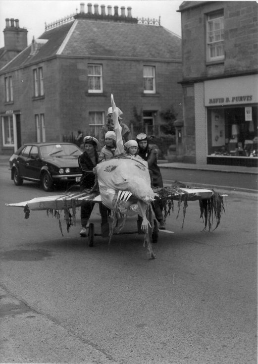'Jaws' inc Castle Street during pram race, Dornoch Festival week