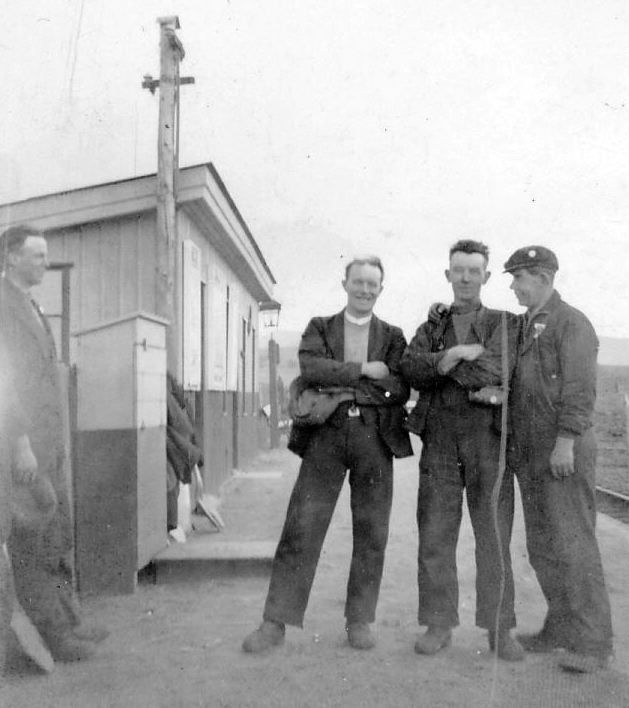 Three railway workers at Skelbo station
