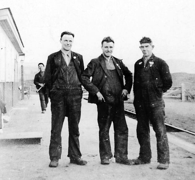 Four railway workers at Skelbo station