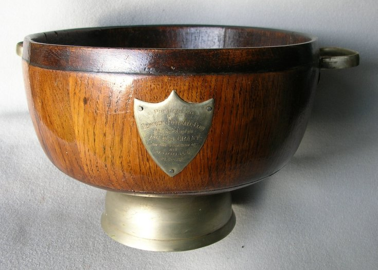 Wooden bowl with inscribed shield.
