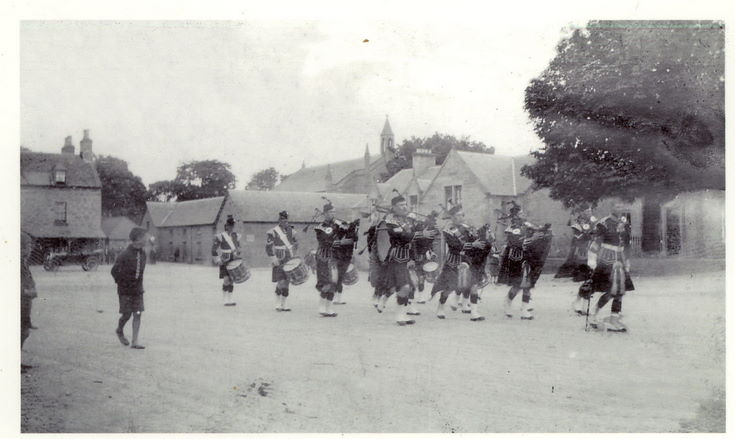 Donoch Pipe Band on parade in The Square, Dornoch c 1910