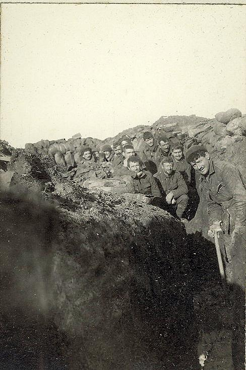 'A' Company's trenches shoveling out the mud