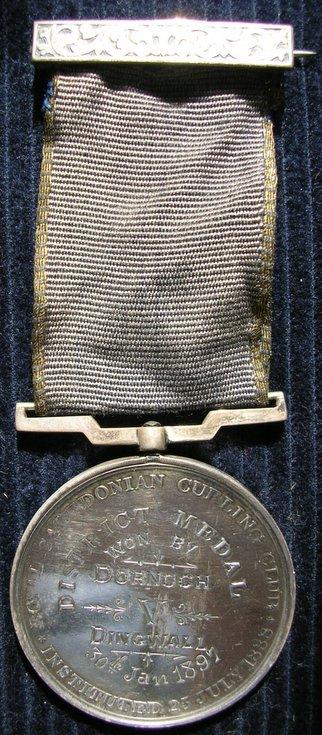 Curling club medal won by Dornoch 1897