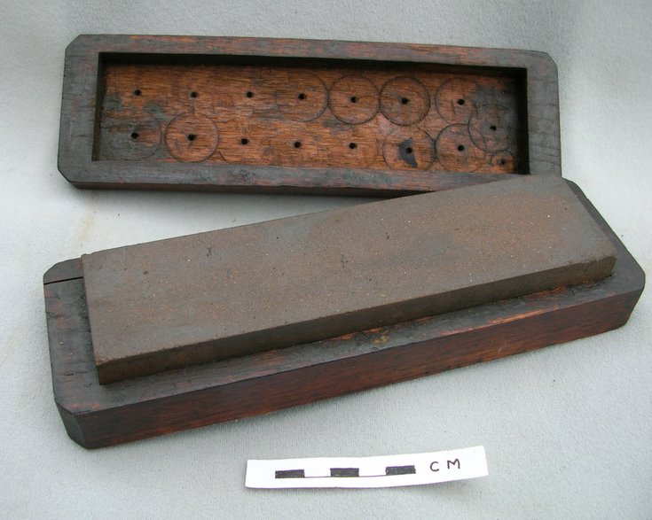 Sharpening oil stone in a wooden box