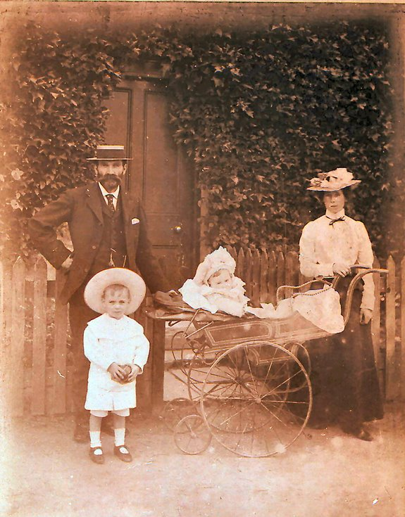 Mr MacLennan, Grocer, with wife, son and baby
