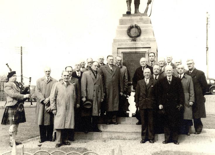 Ex Serviceman grouped at the Dornoch War Memorial